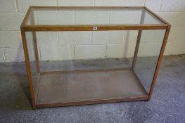 A Large Vintage Oak Shop Cabinet, Having glazed panels, open to the back, 87cm high, 122cm wide,