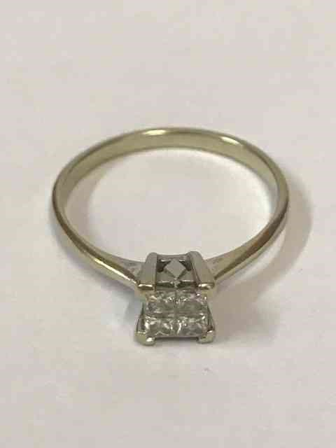 Lot 2 - A Four Stone Ring, Square cut setting, white metal shank