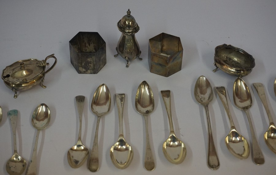 Lot 17 - A Mixed Lot of Silver, to include napkin rings, condiments and tea spoons, 16oz, approximately 25