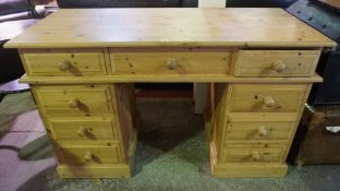 Pine Kneehole Desk, Having three assorted drawers, above two four drawer pedestals, 82cm high, 140cm
