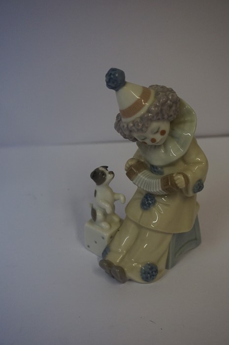 Lot 42 - Two Lladro Figures, Modelled as a girl with dog and a clown with dog, in original boxes, also with a