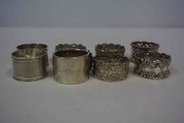 Four Silver Napkin Rings, one example Chinese, also with four silver plated napkin rings, (8)