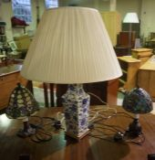 Two Tiffany Style Table Lamps, with shades, also with a Chinese style pottery vase / lamp with