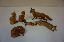 Three Beswick Fox Figures, also with three other ceramic figures of foxes, (6)