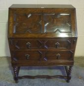 Jacobean Revival Oak Writing Bureau, Having a fall front enclosing drawers and pigeon holes, above