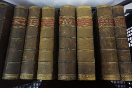 Seven Leather Half Calf Novels by Charles Dickens, circa mid 19th century, also with a 19th