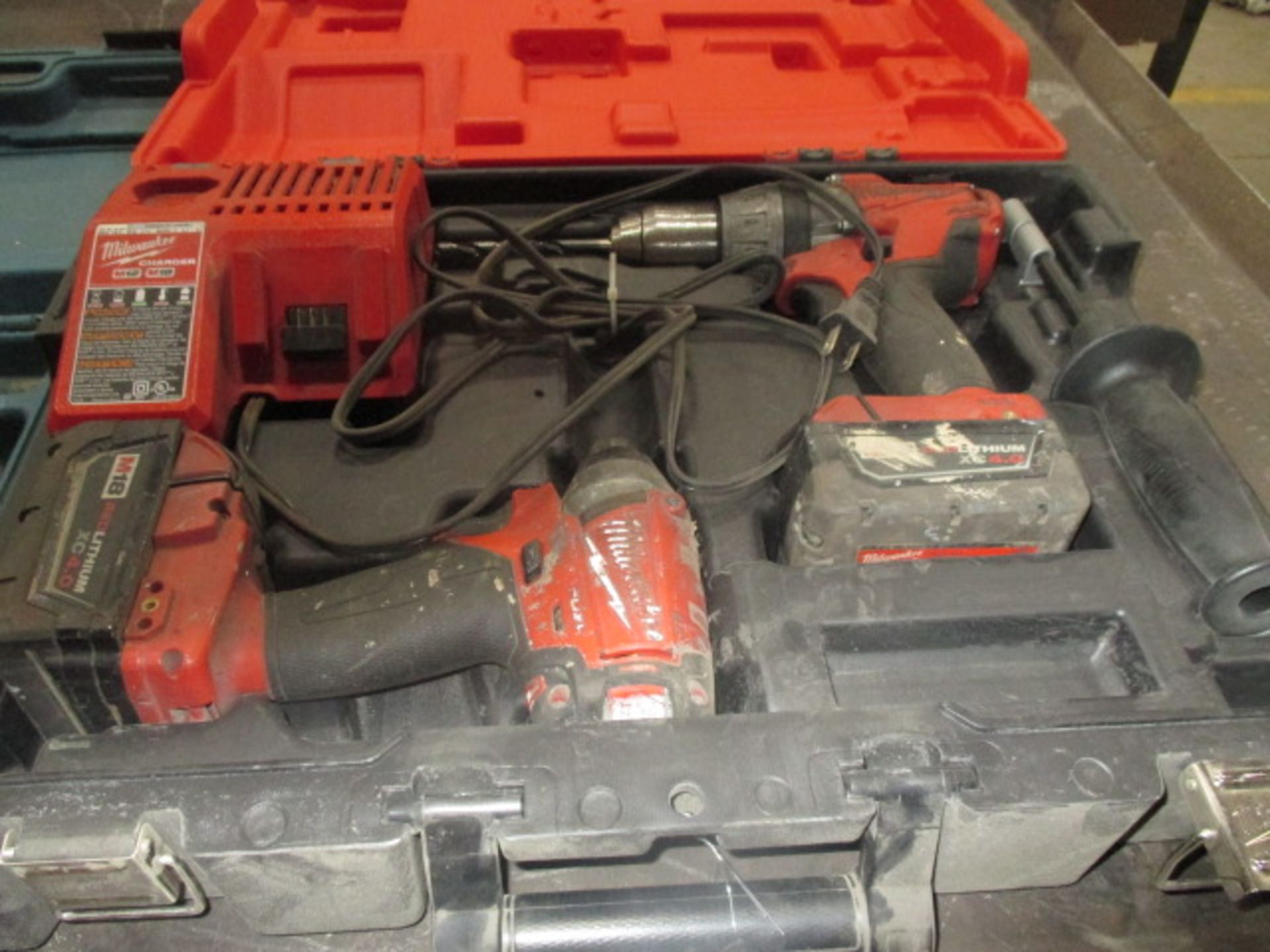 Lot 214 - Milwaukee Drill Set with Charger and 2 Batteries and Makita Jig Saw