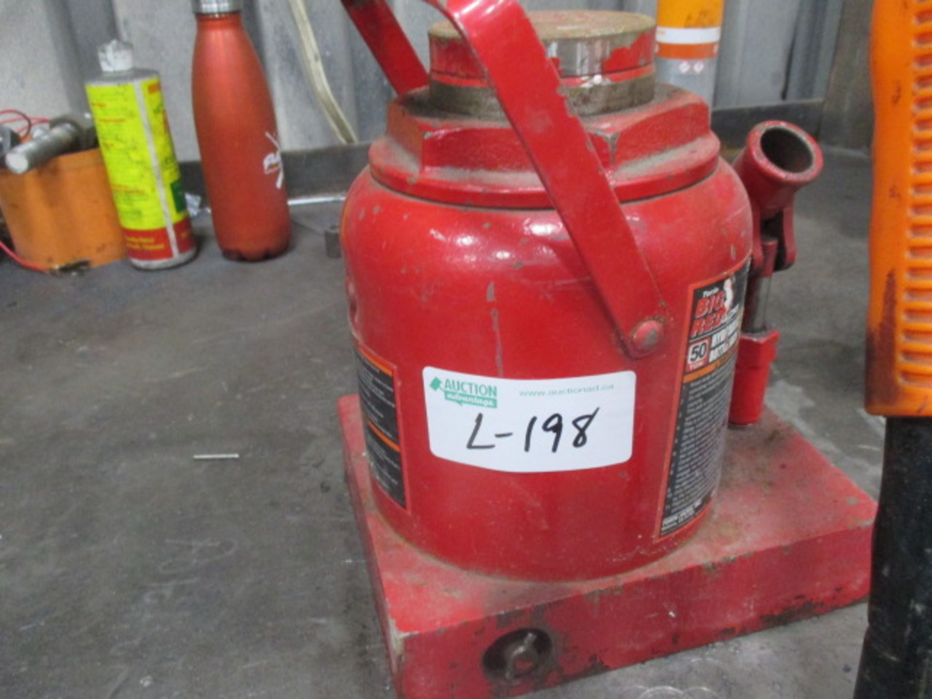 """Lot 198 - Metal Table with 50 ton hydraulic jack and rolling magnet (vice 4' X 30"""")"""