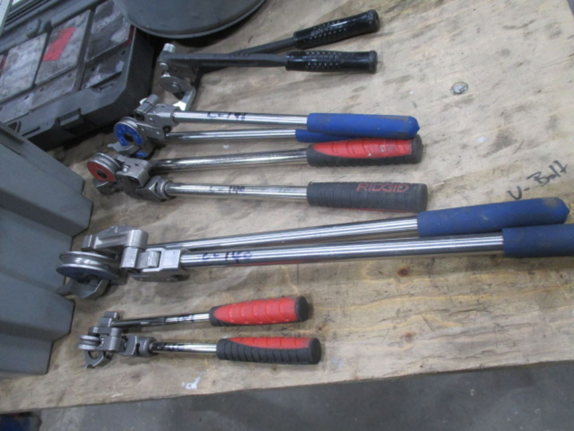 """Lot 140 - Bin Lot of 5 Misc Pipe benders & 2 - 4ft """"T"""" Squares"""