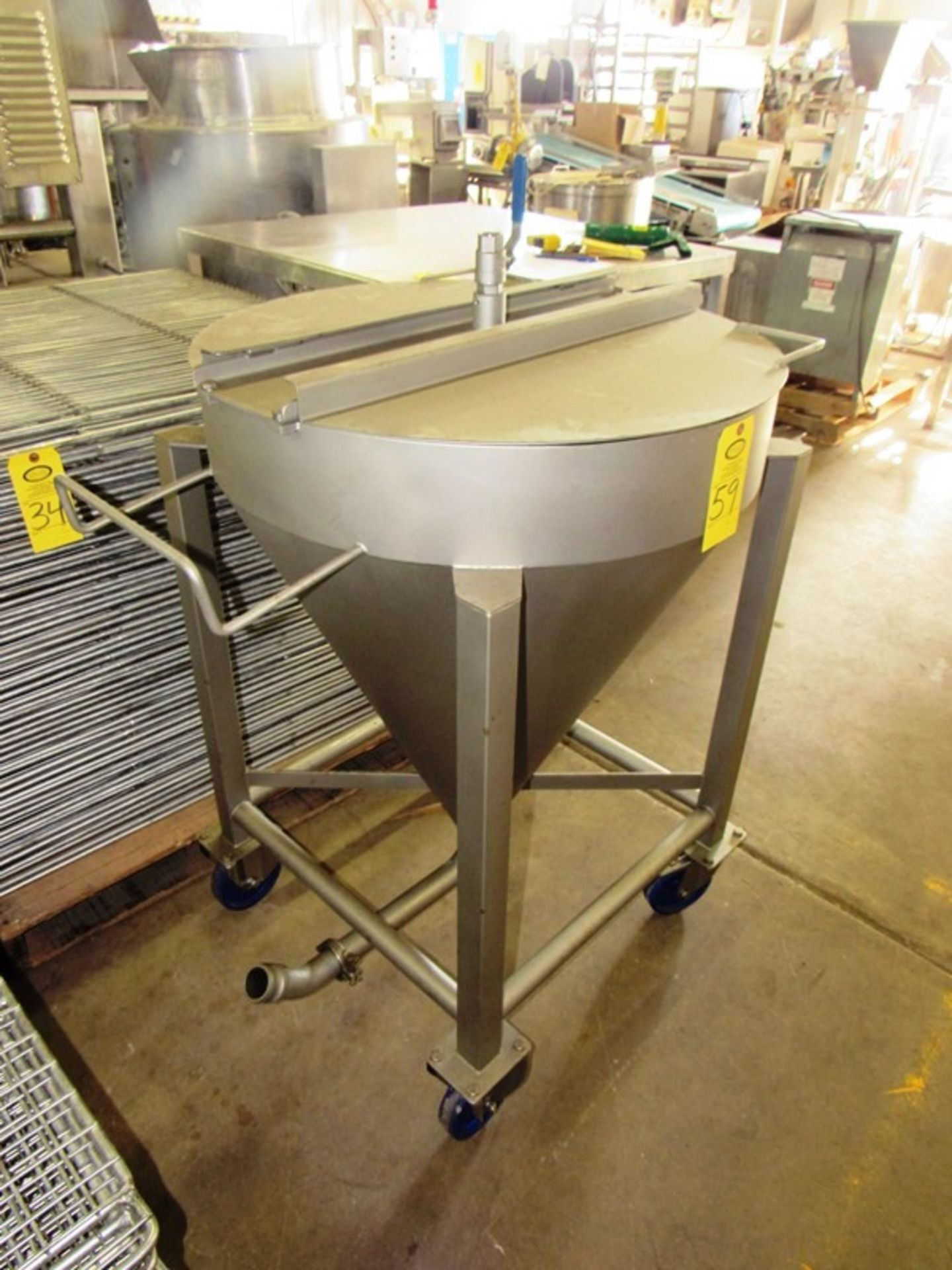 "Lot 59 - Stainless Steel Tank, 32"" Dia. X 40"" D tapered, 1"" top valved inlet, 2"" bottom outlet on wheels"