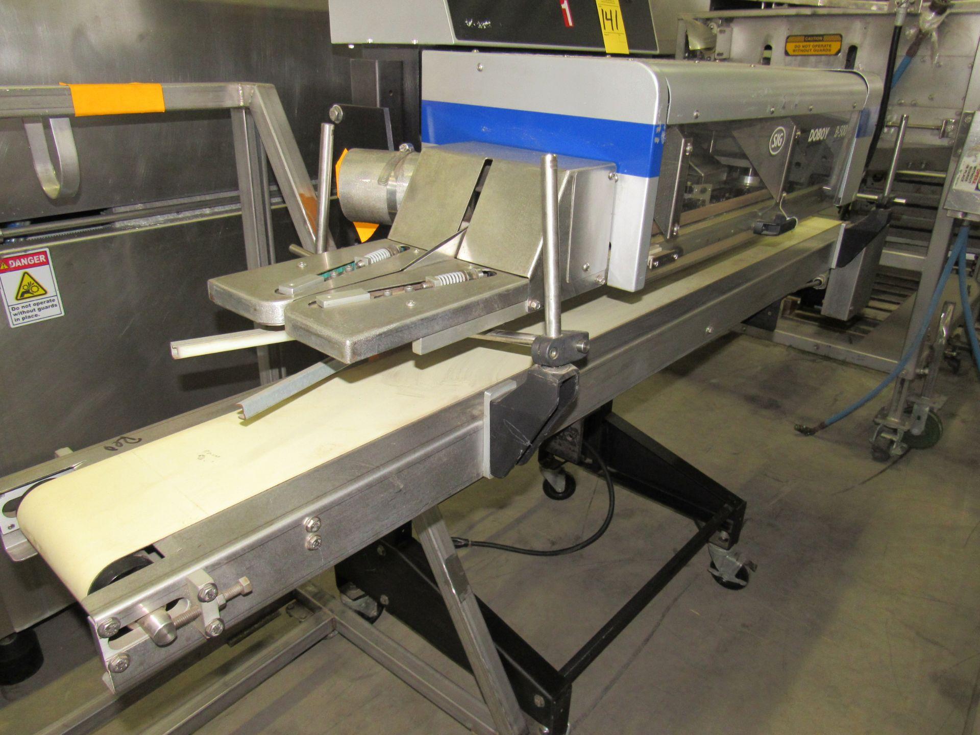 "Lot 141 - Doboy Mdl. B-500 Continuous Bag Sealer, adjustable feed conveyor, 54"" long sealer, 77"" long conveyor"