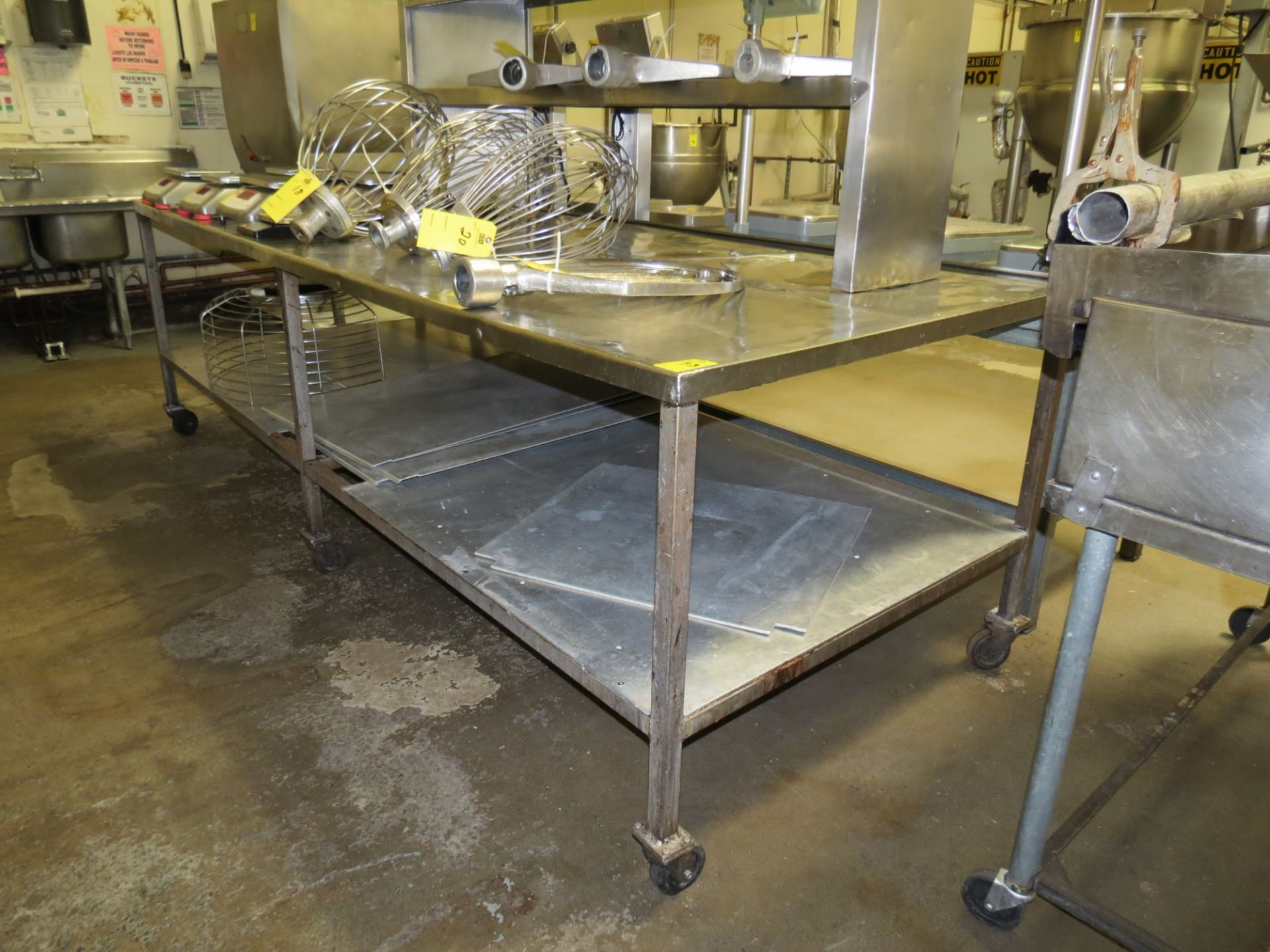 Lot 43 - STAINLESS STEEL MOBILE TABLE APPROX. 4FT X 10FT