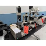 Lot 834 - Olympus IM stero zoom microscope with light source and Olympus burner unit, located B wing, 3rd