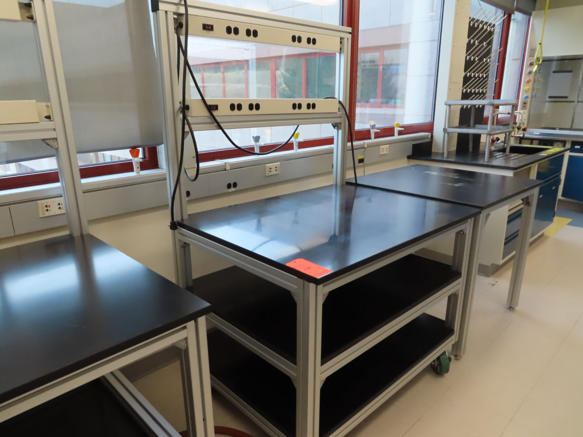 Lot 1784D - Lot of (12) rolling lab tables, no drawers, located in B wing, 4th floor, room 447A