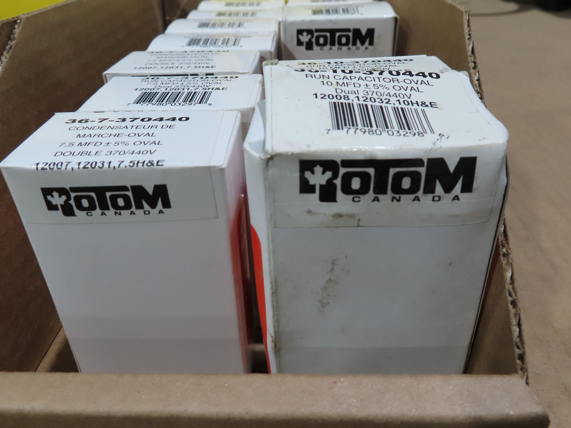 Lot 29 - Qty 12 Rotom capacitors, (9) model 36-7-370440, (3) model 36-10-370440, new in boxes, as always,