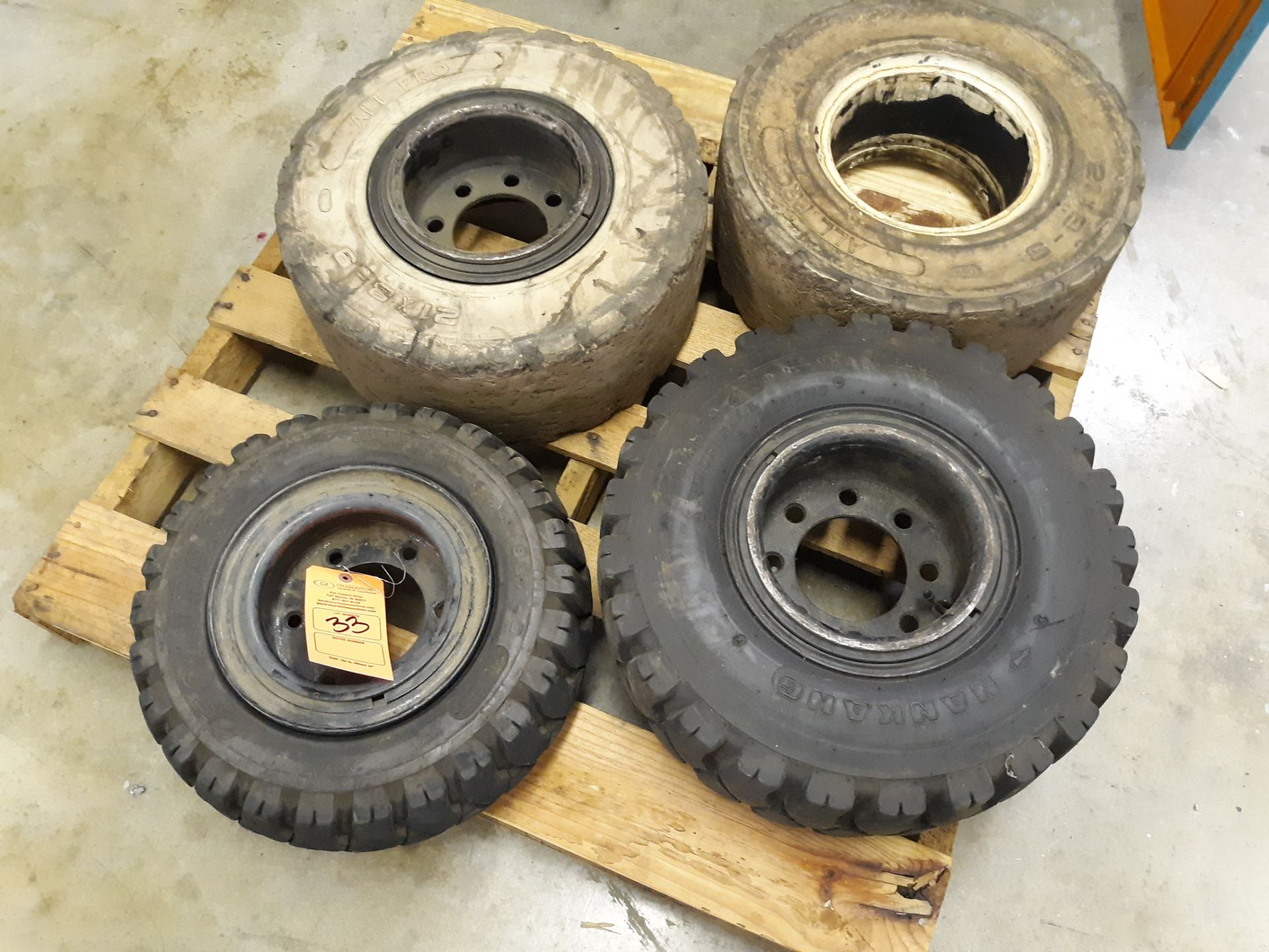 Lot 33 - (4) FORKLIFT TIRES (2) SOLID WHITE RUBBER 21 X 8-9; RIGGING FEE $10