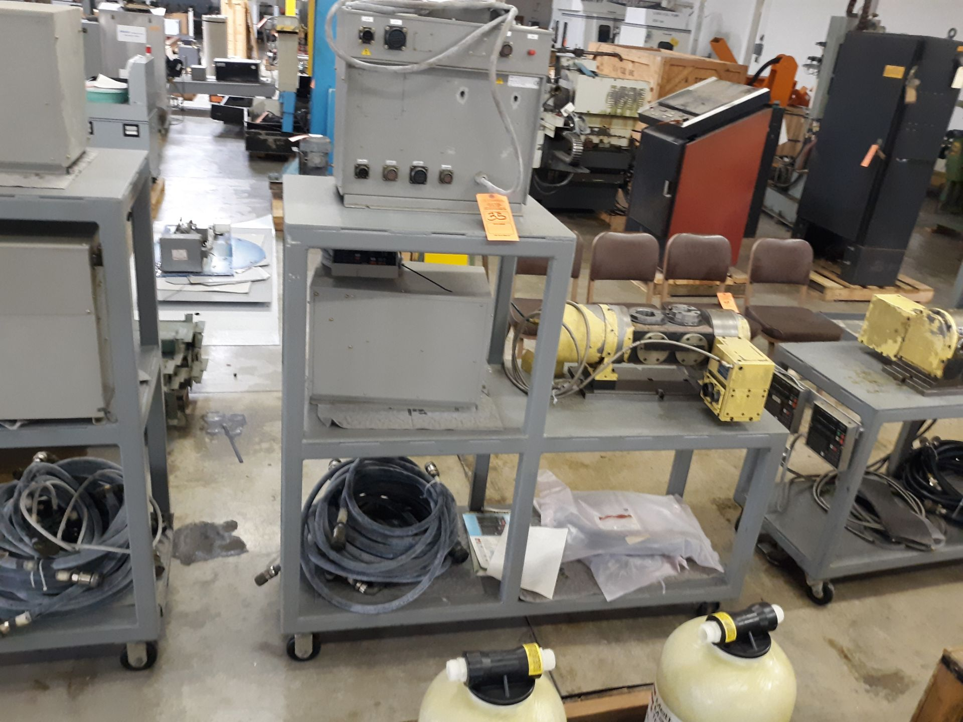 Lot 35 - NIKKEN ROTARY TABLE W/CABLES W/(2) NEC Z3BF CONTROL UNITS & (2) NIKKEN KEYPADS; RIGGING FEE:$10