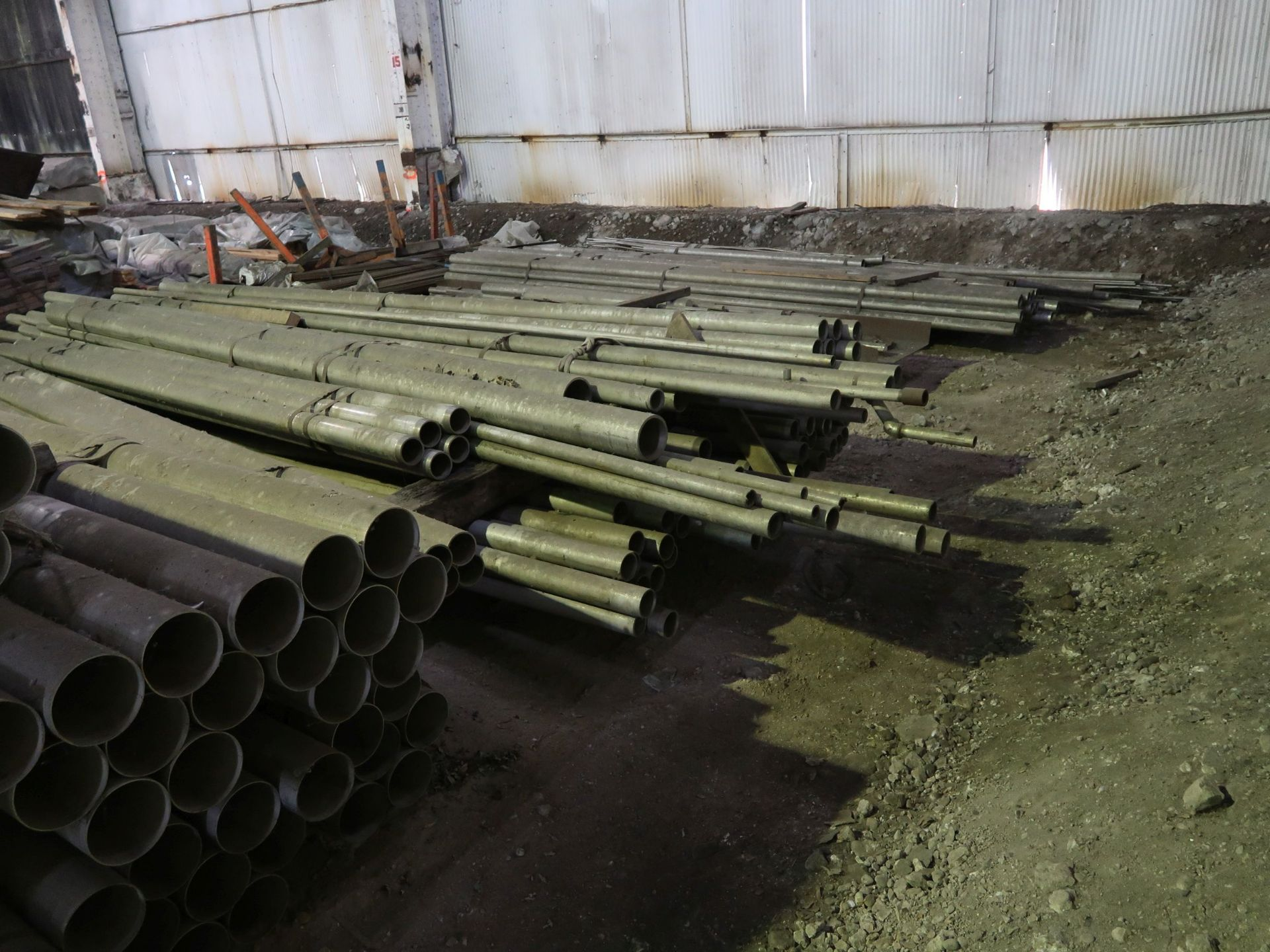 "Lot 313 - LARGE QUANTITY STAINLESS STEEL MATERIAL INCLUDING 6"" DIAMETER X 20' LONG PIPE, 3"" PIPE, ASSORTED"