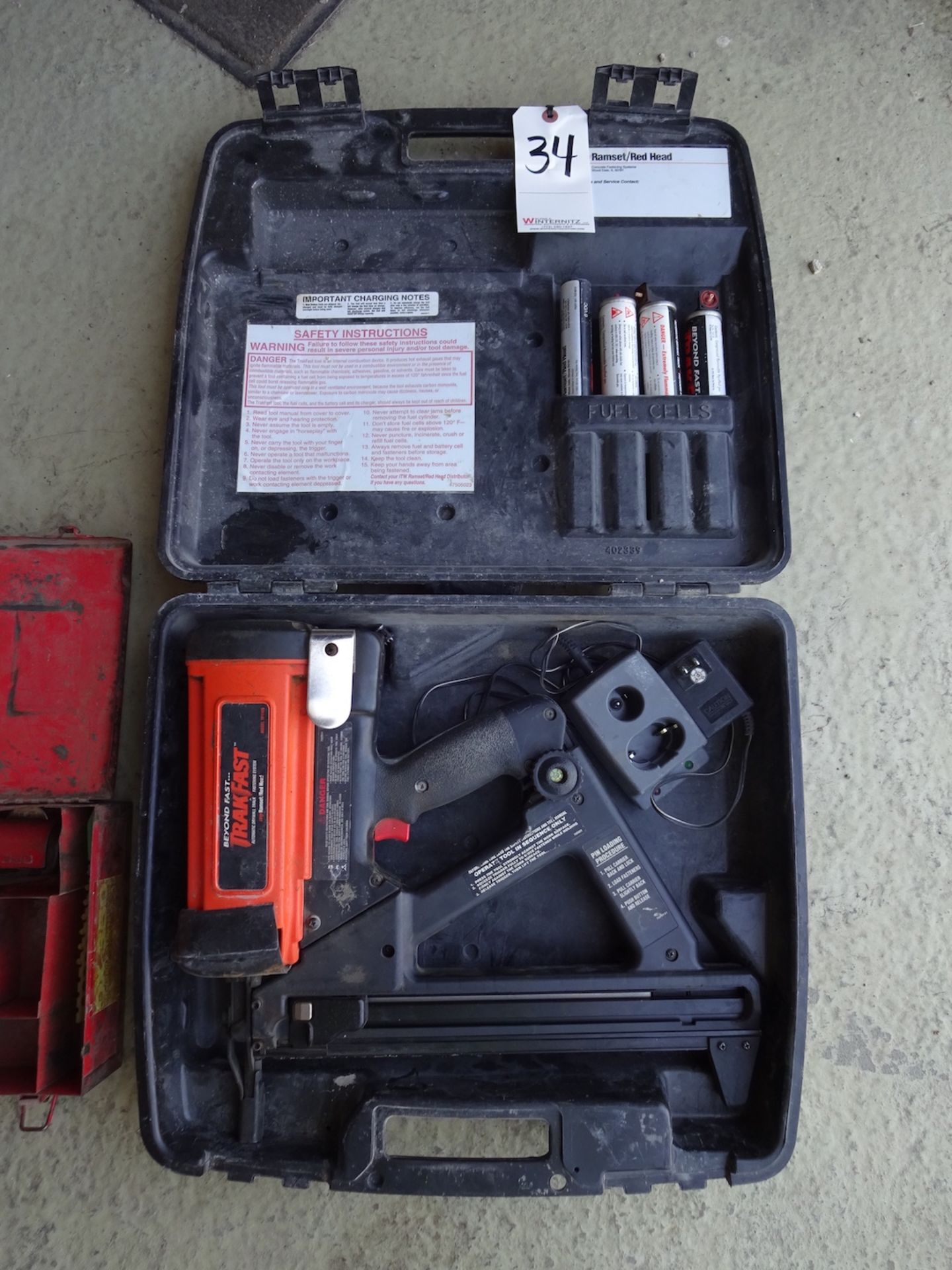 Lot 34 - TRAK FAST CORDLESS DRYWALL FASTENER MODEL TA100 WITH FUEL CELLS AND CASE