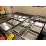 Assorted Button, Sole and Mat Molds Rigging Fee: 75