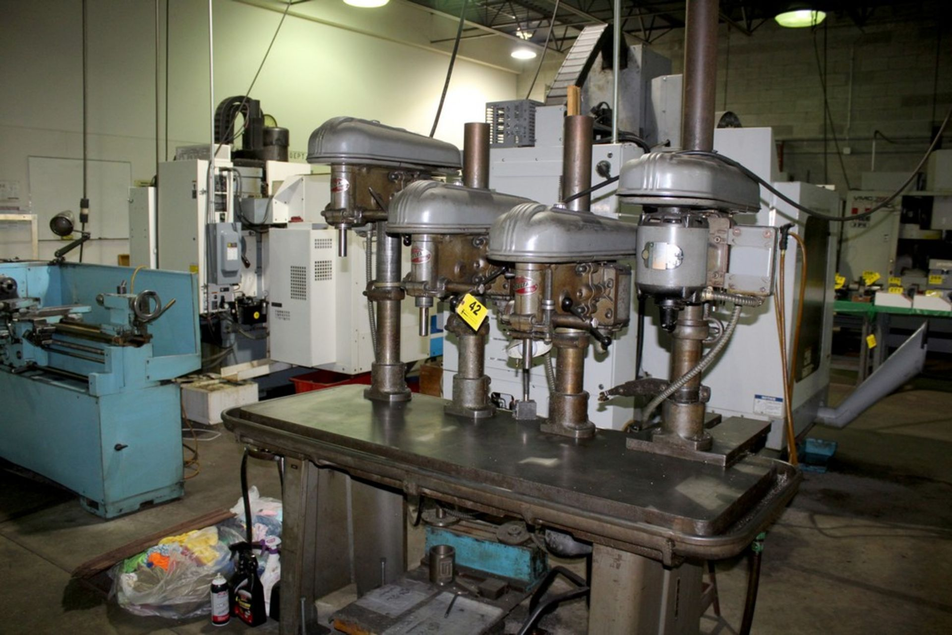 "Lot 42 - DELTA 17"" FOUR SPINDLE DRILL, 65"" X 24"" PRODUCTION TABLE"