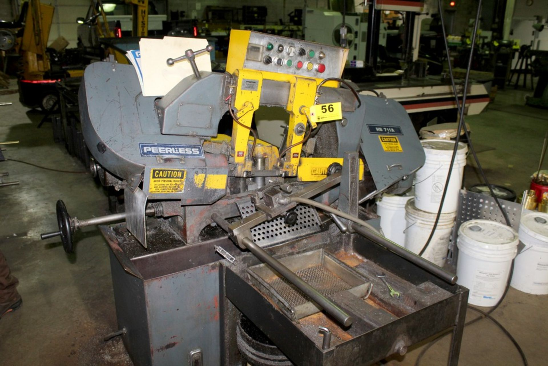 Lot 56 - PEERLESS HB711A BANDSAW WITH ROLLER CONVEYOR AND STOCK STAND