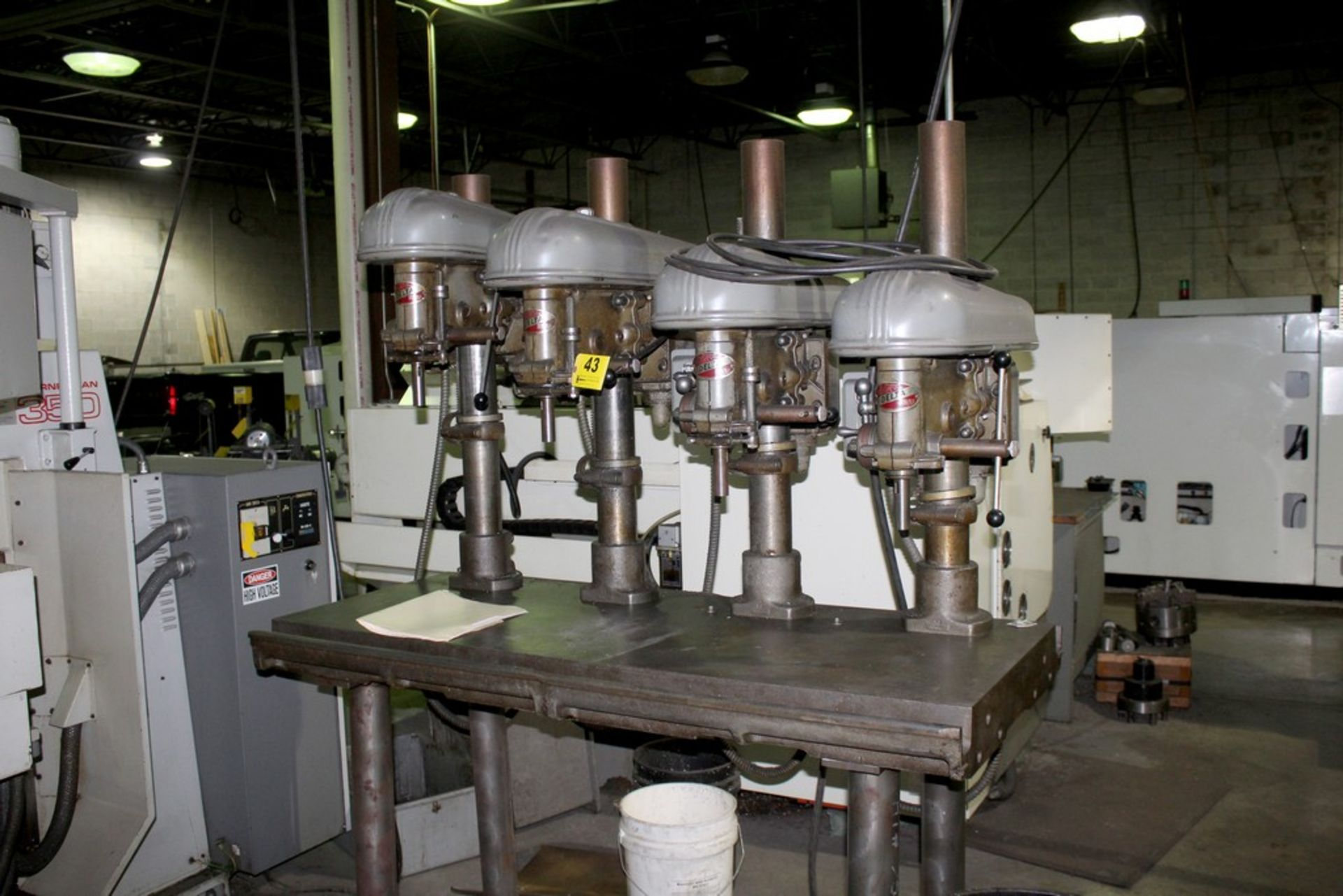 """Lot 43 - DELTA 17"""" FOUR SPINDLE DRILL, 61"""" X 24"""" PRODUCTION TABLE"""