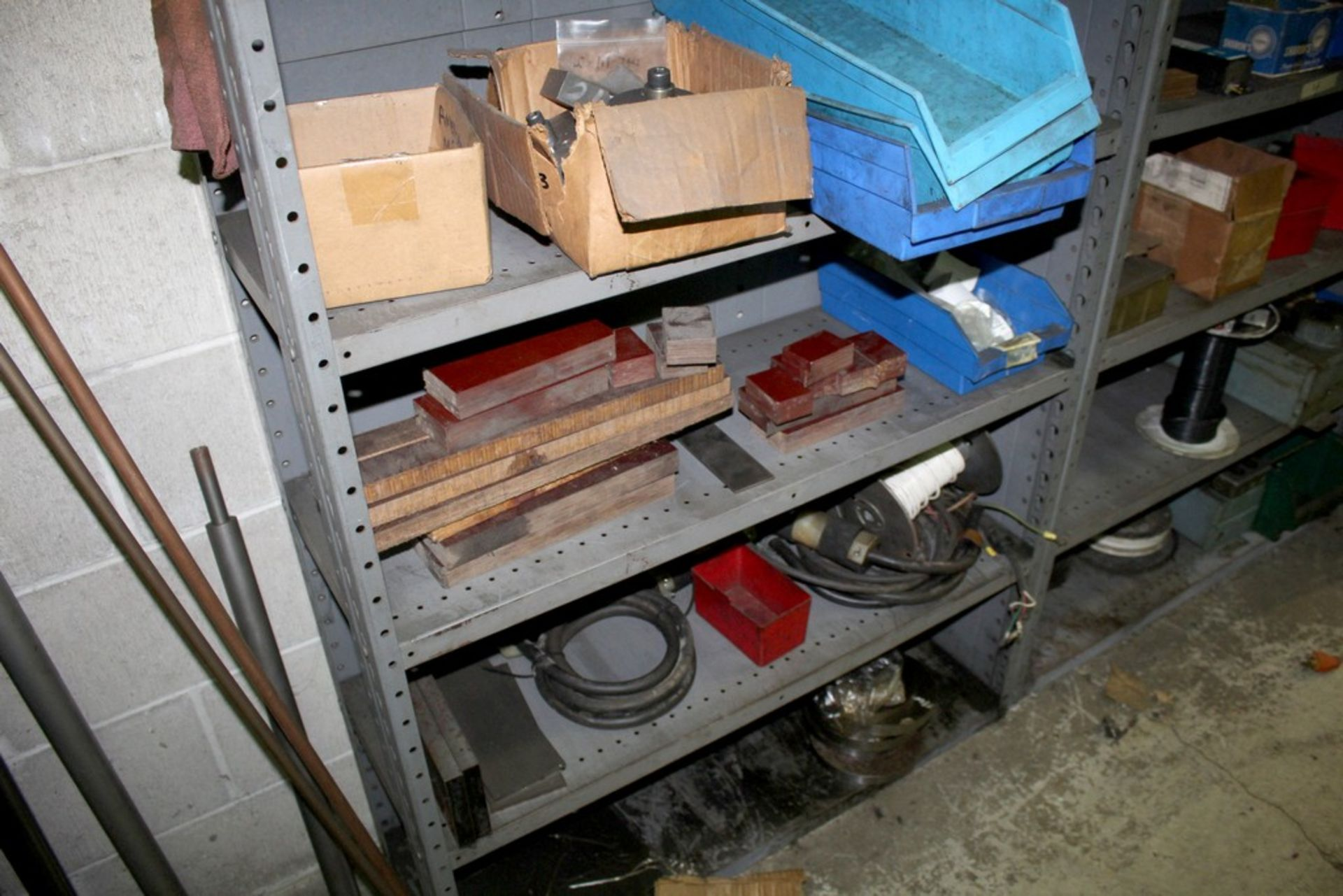 Lot 50 - SECTIONS OF ADJUSTABLE STEEL SHELVING WITH CONTENTS