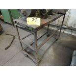 "Steel work cart on caster, 36"" x 14"" x 28""."