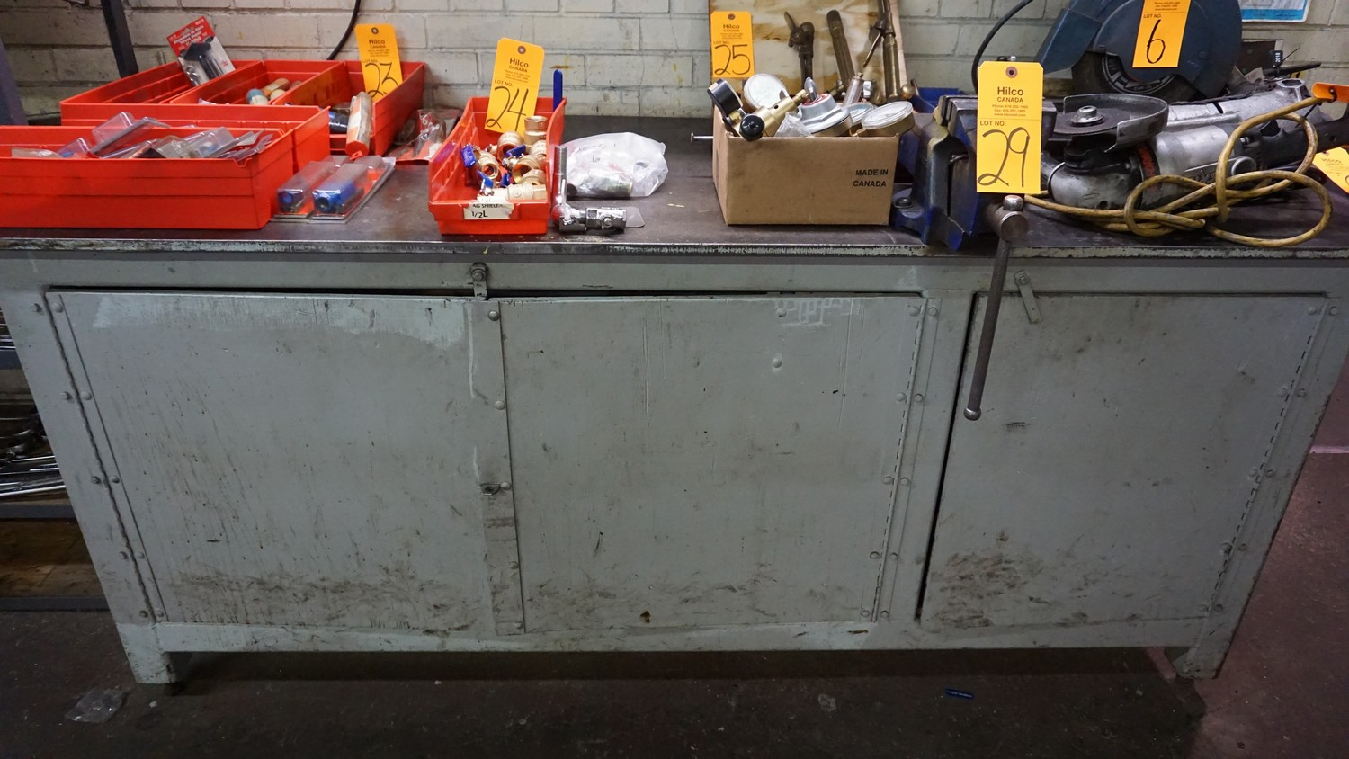 "Lot 29 - 84"" x 32"" Metal Work Bench with Vise (No Contents)"
