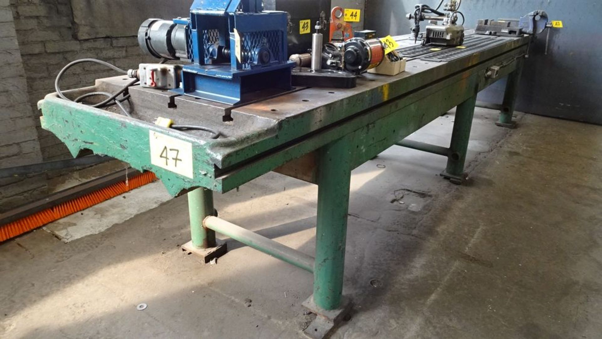 """Lot 47 - 32""""W X 14' LONG X 35"""" HIGH SLOTTED LAY-OUT TABLE C/W RECORD 6"""" BENCH VISE (RIGGING FEE $25)"""