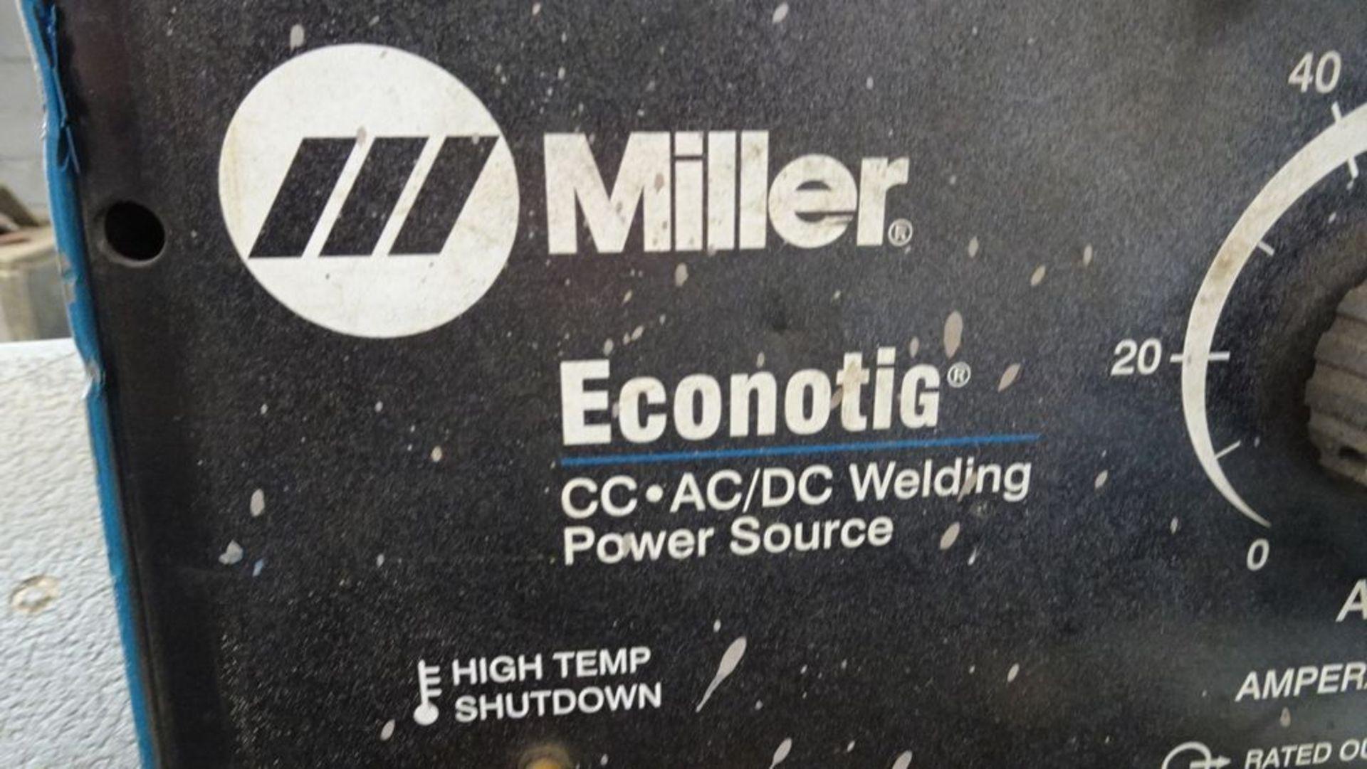 Lot 51 - MILLER ECONOTIG WELDER, 1/60/230V, C/W LEADS, GROUND CABLE & CART, S/N 903367