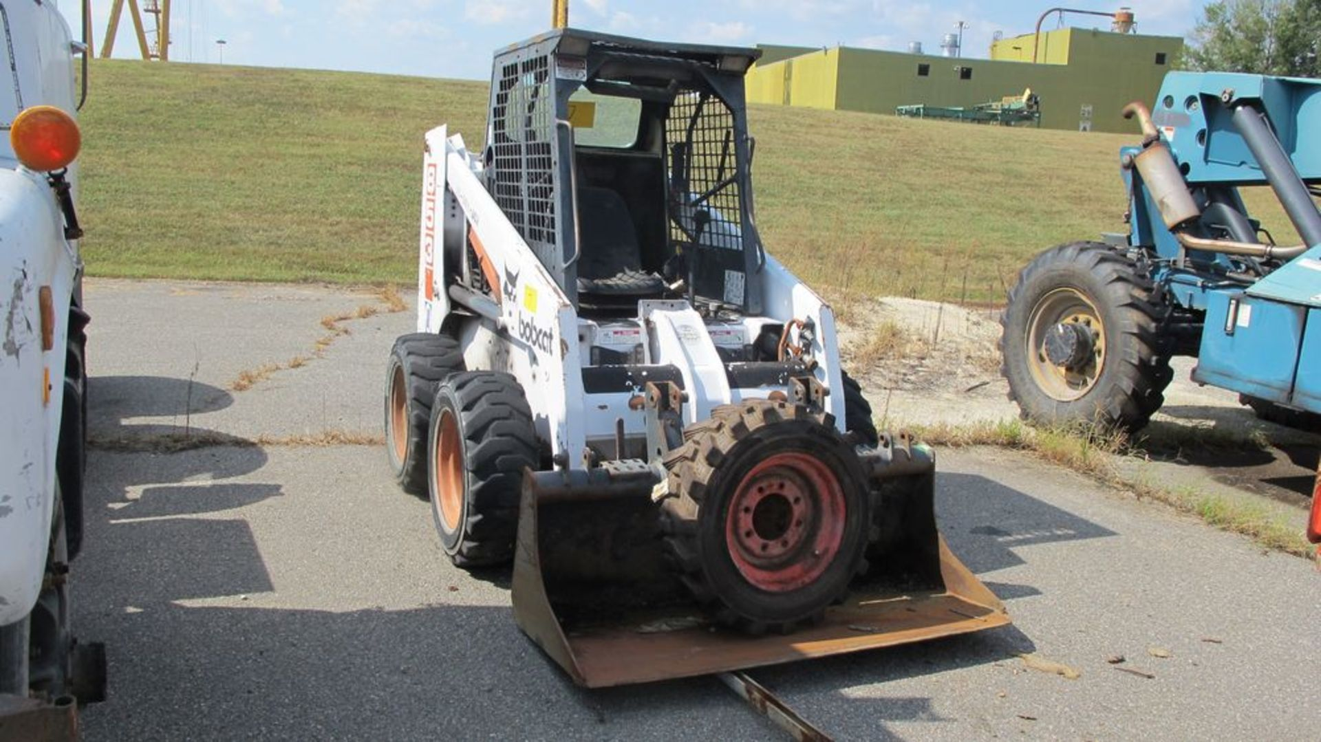 Lot 7 - BOBCAT 853 W/BUCKET ATTACHMENT (NEEDS REPAIR) (WAREHOUSE 30 - PARKING LOT)