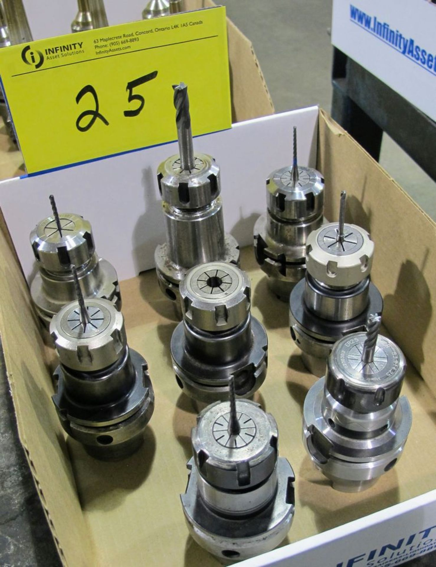 Lot 25 - LOT OF (8) HSK-A63 TOOL HOLDERS W/ ASST. TOOLING