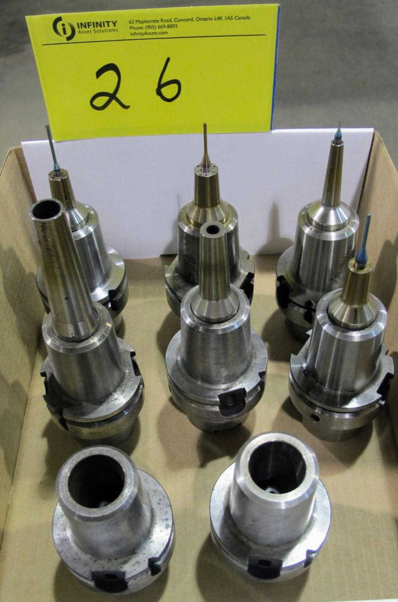 Lot 26 - LOT OF (8) HSK-A63 TOOL HOLDERS W/ ASST. TOOLING