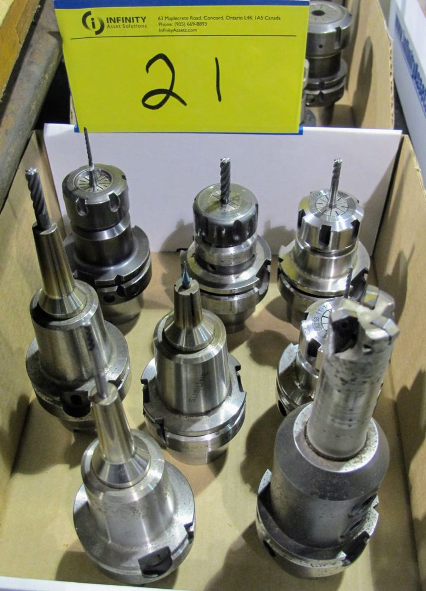 Lot 21 - LOT OF (8) HSK-A63 TOOL HOLDERS W/ ASST. TOOLING