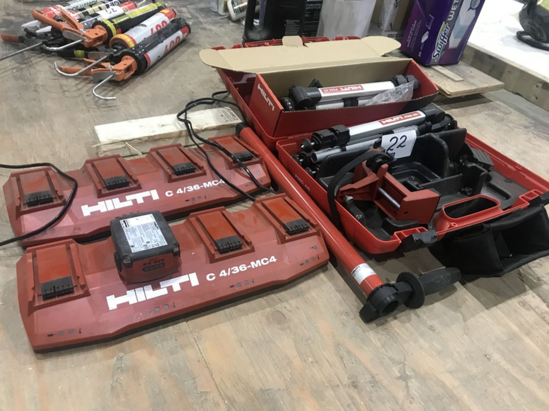 Lot 22 - 2 HILTI GANG CHARGERS, 2 TRIPODS & BATTERY