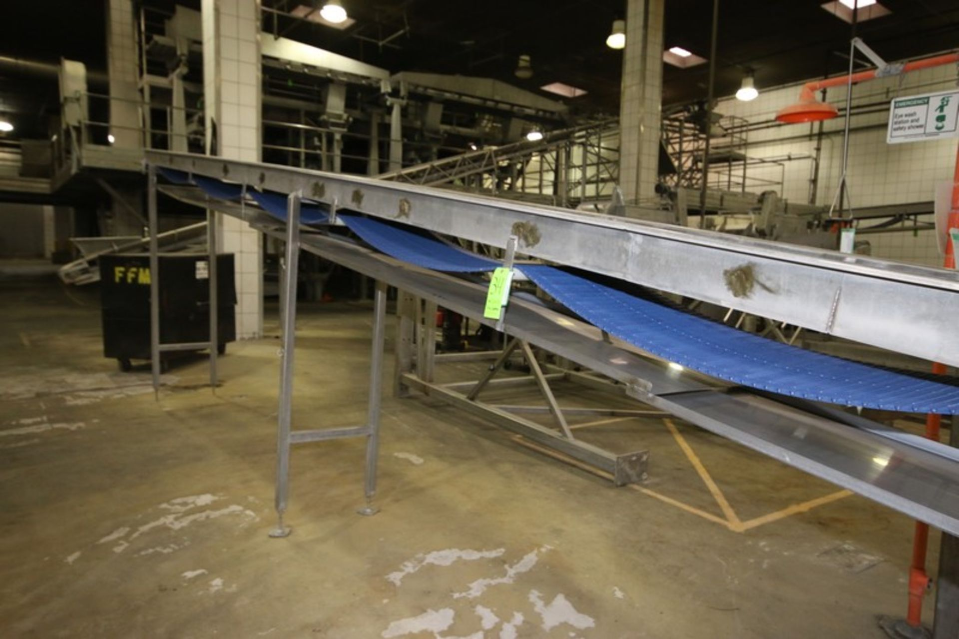"Lot 34 - S/S Incline Conveyor, Aprox. 40' L x 28"" W Hydraulic Operated with S/S Legs"
