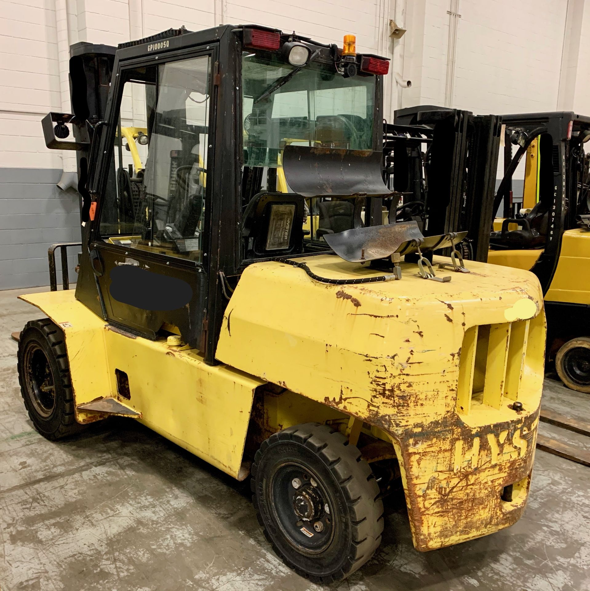 Lot 4A - 1999 HYSTER 10,000-LB. CAP. FORKLIFT, MODEL: H100XL, LPG, PNEUMATIC TIRES, 3-STAGE MAST, 3,450 HRS