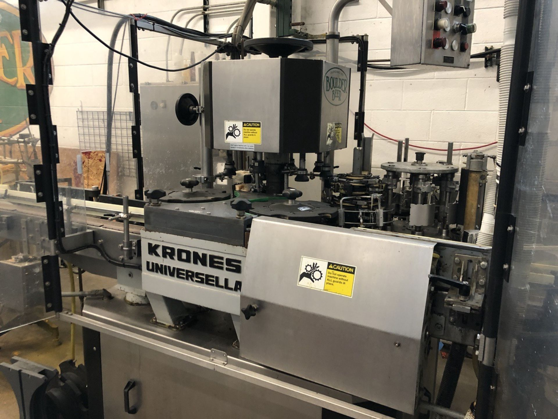 Lot 54 - Krones Universella 6-Station Bottle Labeler, 110/120/130 Speed Sensor | Sub to Bulk | Rig Fee: $650