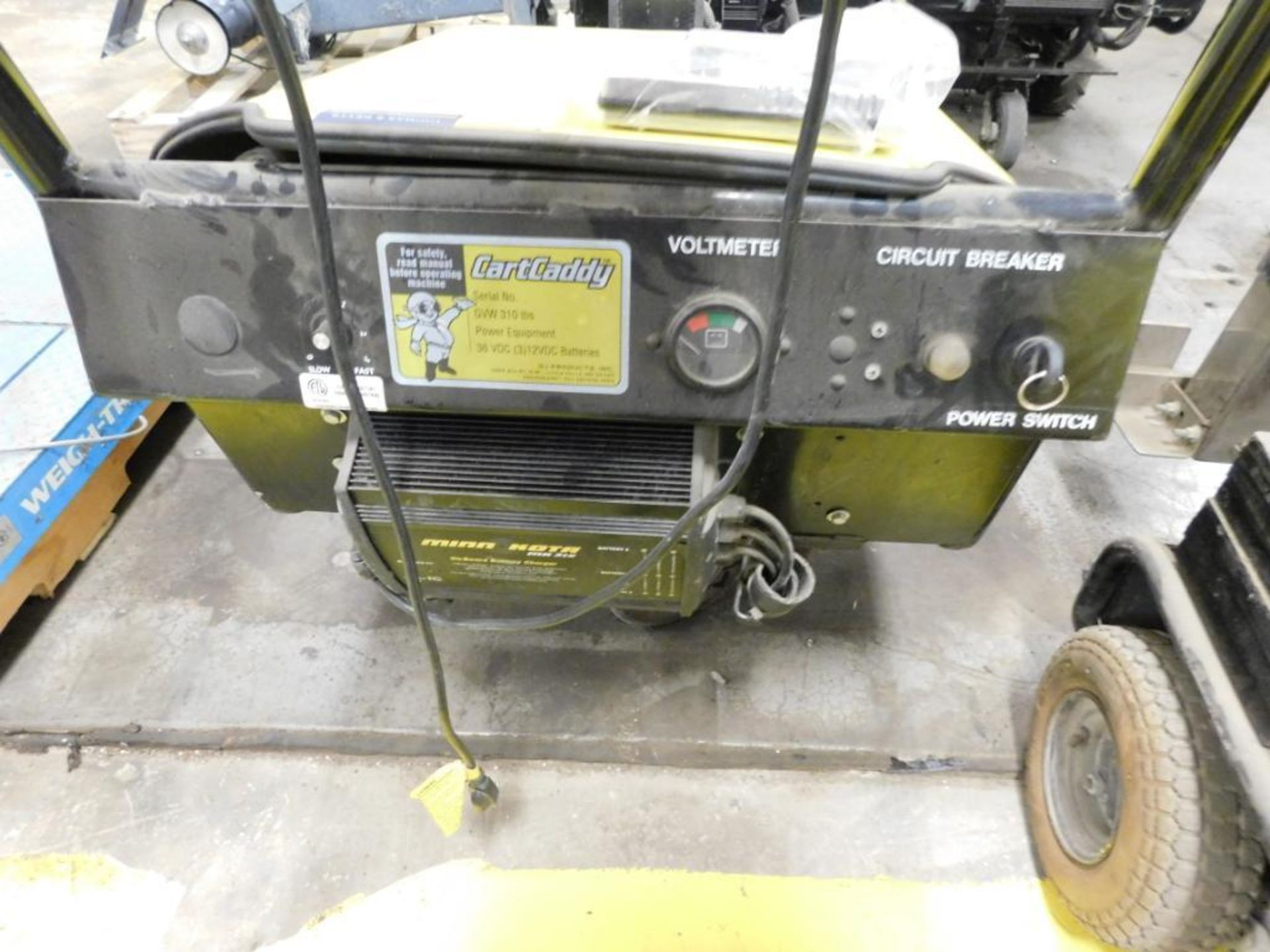 Lot 44 - ELECTRIC CART PUSHER, CART CADDY 5W, 36 v., w/onboard charger