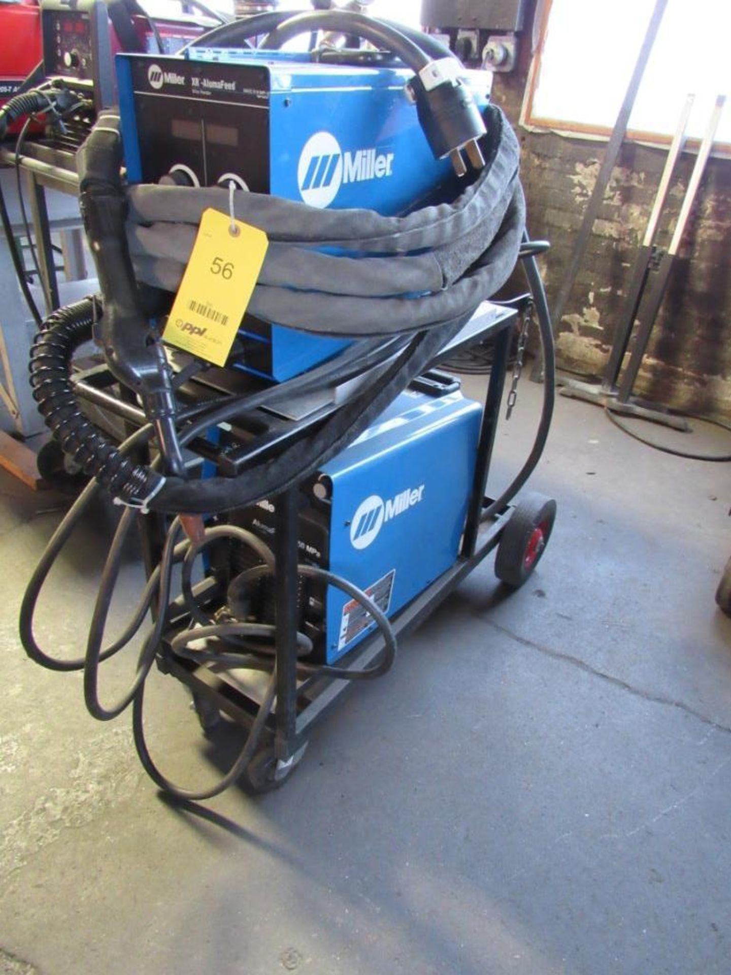 Lot 56 - Miller 400 Amp XR Acumafeed MIG Welder, Wire Feed, Cable, Gun, Flow Meter, with Miller 350 Amp Aluma