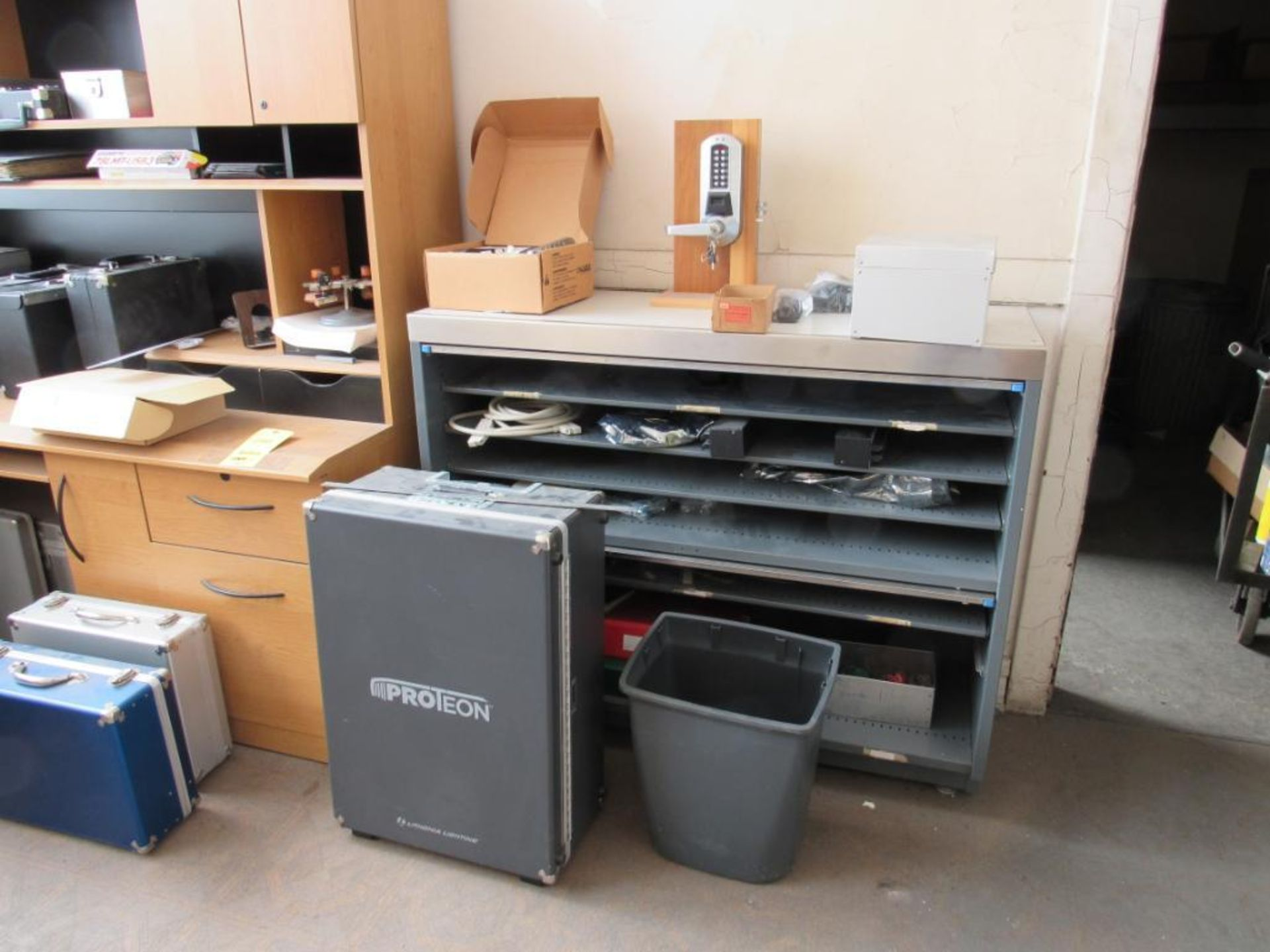Lot 246 - LOT: Contents of Office including (1) Desk with Return, (1) Cabinet, Assorted Aluminum Cases (no bui