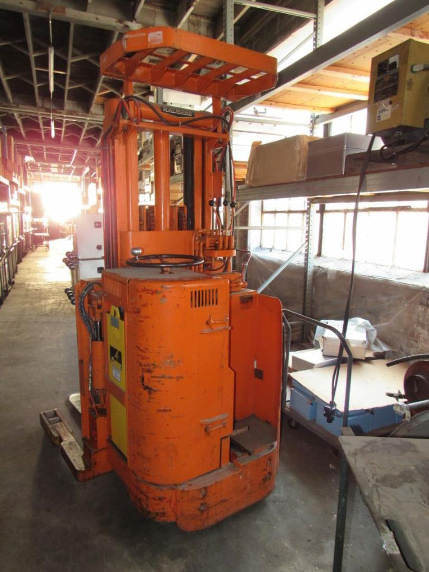 Lot 140 - Raymond 3000 lb. Stand-up Electric Forklift Model E3RT-0HA, S/N 843-1978, with Charger