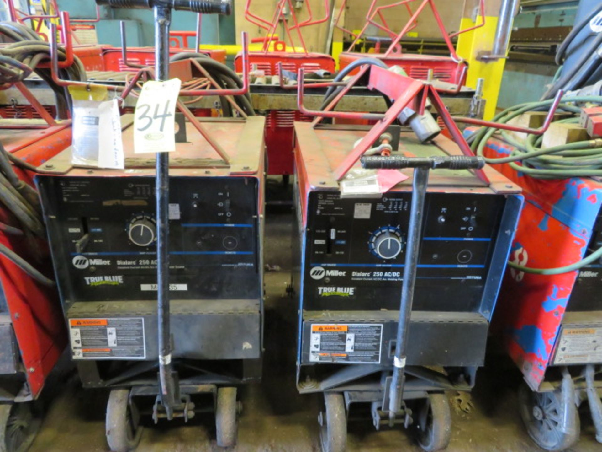 Lot 34 - (2) MILLER DIALARC TIG WELDERS W/CARTS