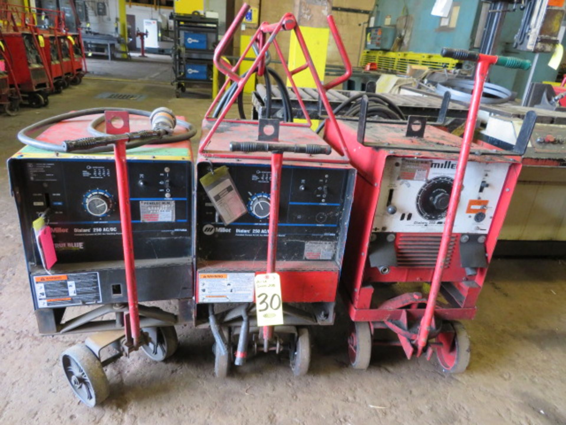 Lot 30 - (3) MILLER DIALARC TIG WELDERS W/CARTS