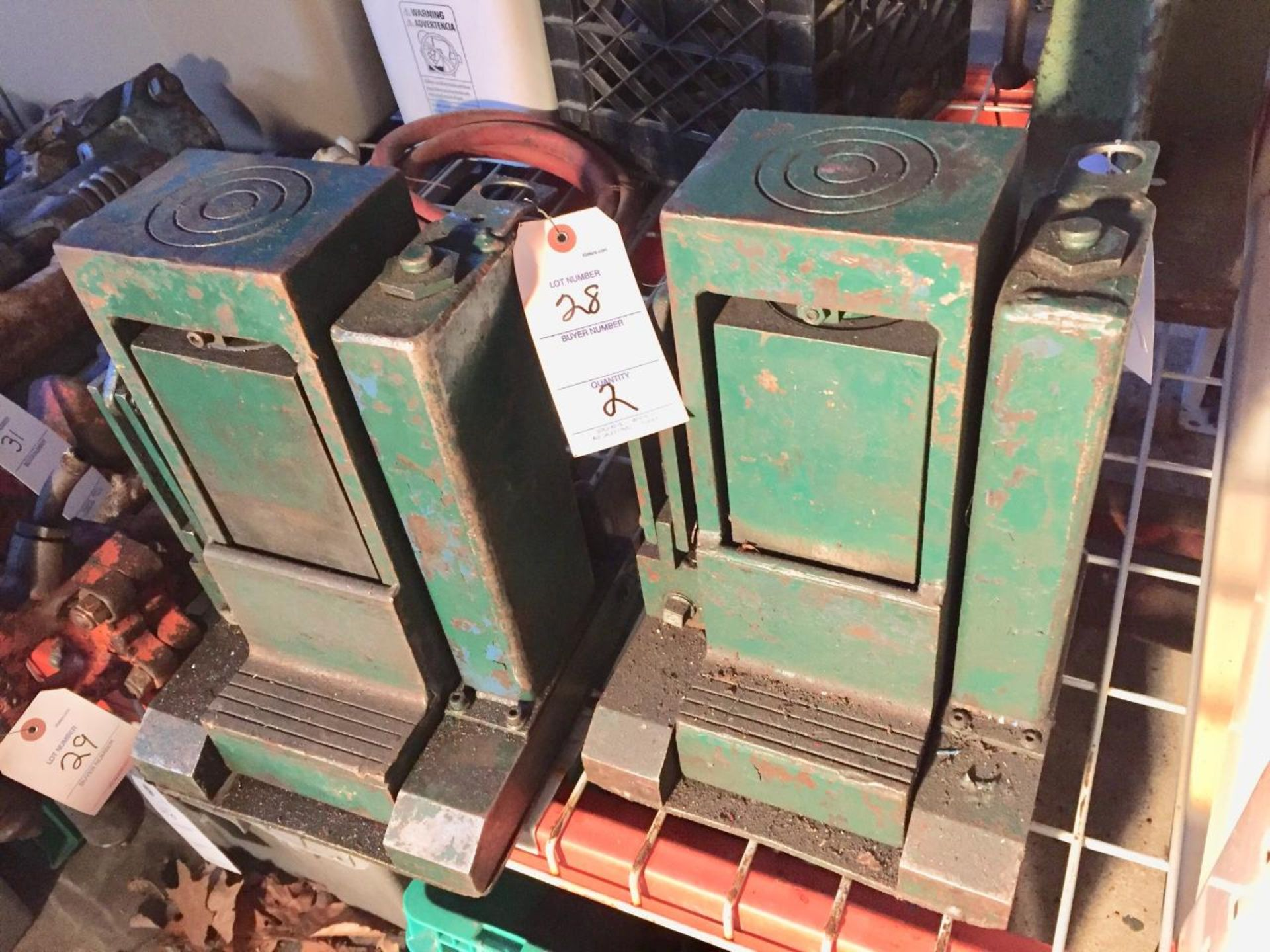 Lot 28 - (2) Large Manus Bottle Jacks, green