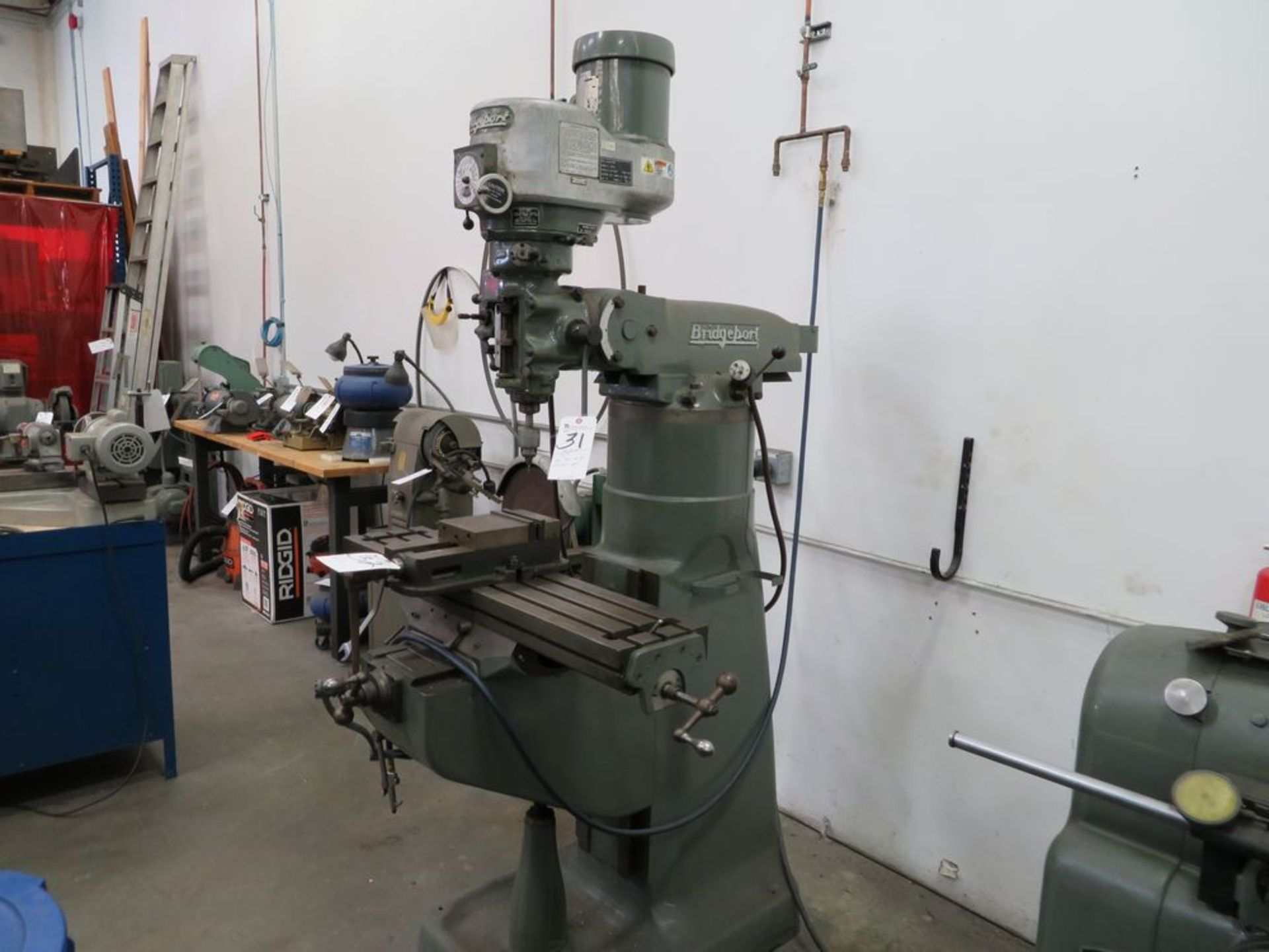 "Lot 31 - Bridgeport 1 ½ hp Vertical Mill, Var. Spd. w/ 9"" x 42"" Table; S/N 120496"