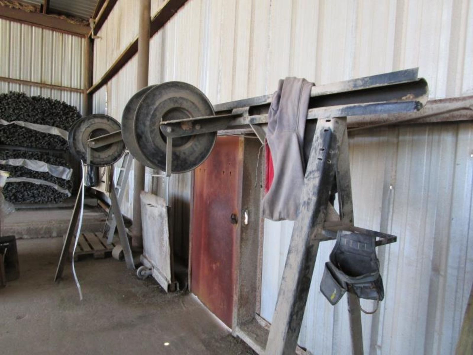 Lot 53 - Metal A-Frame stand with (2) banding rolls