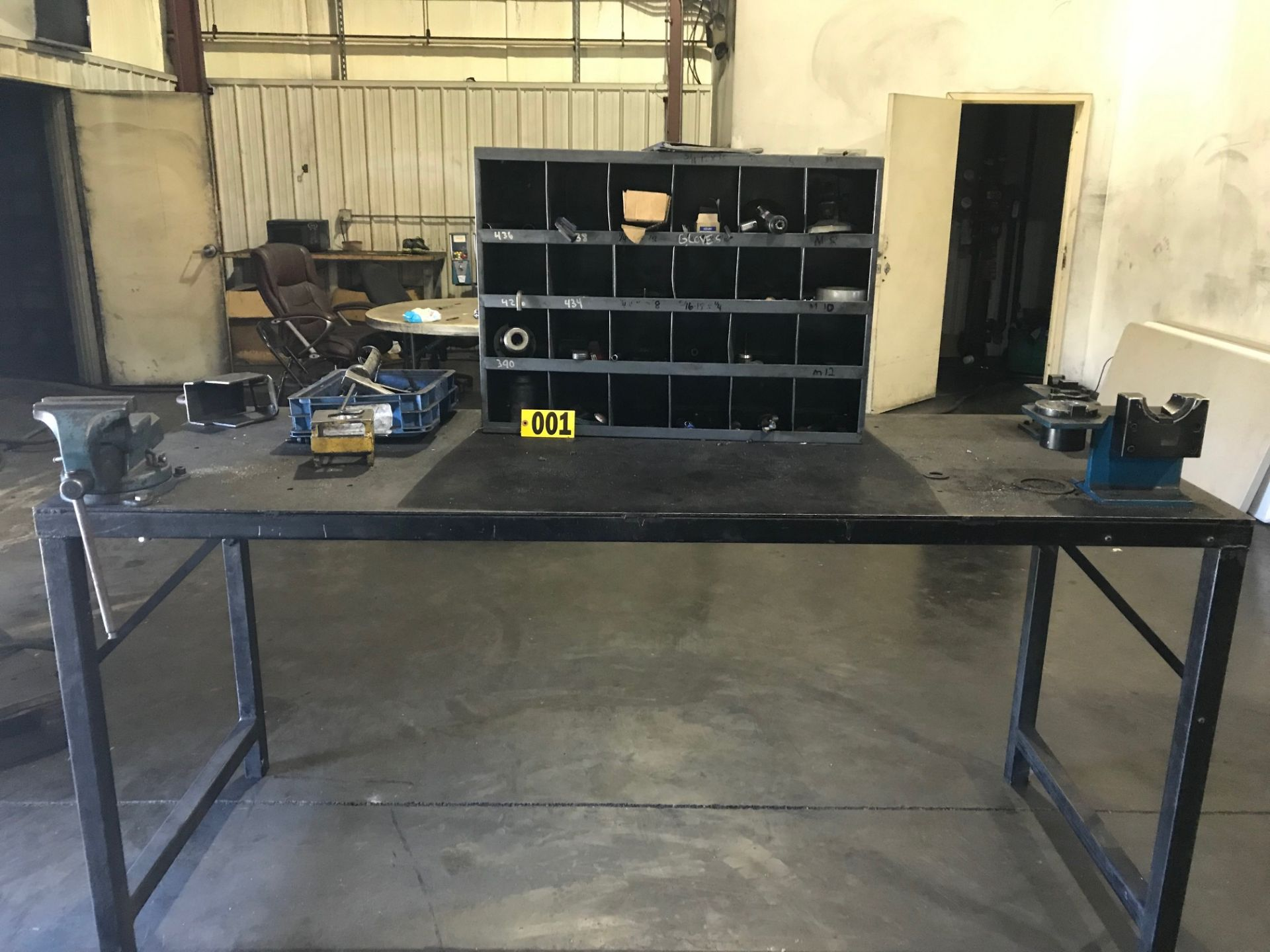 Lot 1 - Steel work bench w/ vises 7ft x 32in, tool cabinet & contents